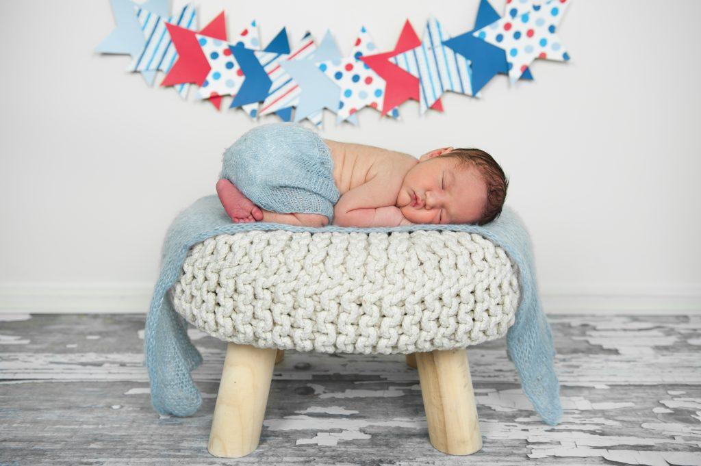 Newborn baby under stars