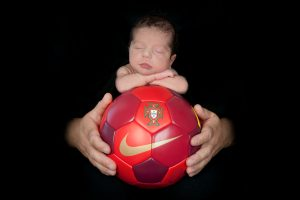 newborn baby on a soccer ball